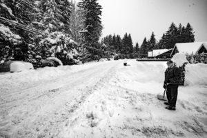 Man shoveling the snow.